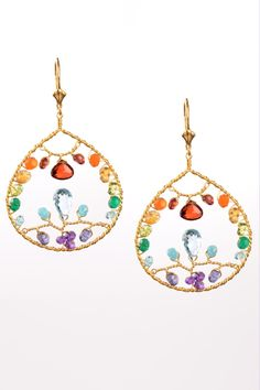 """Harmony's Paradise Garden Earrings feature the spectrum of colors found in her favorite tropical paradises. Garnet, Carnelian, Citrine, Peridot, Green Onyx, Apatite, Blue Topaz, Amethyst & Iolite create a beautifully balanced rainbow of gems that have been woven into Paradise's Garden.    Measurements:hang 2.25"""" L   Paradise Hoop Earrings by Harmony Scott Jewelry Design. Accessories - Jewelry - Earrings Colorado"""