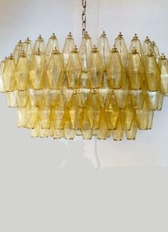Quirky and intriguing Chandelier composed by a cluster of hanging polyhedrons. Available in Amber (picture), Clear or Smoky. Made in Italy with Murano Glass. Venini Style