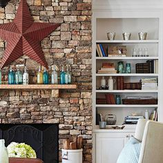 Love this rock fireplace. Rustic Charm - A floor-to-ceiling cobblestone fireplace facade offers a timeless country look. Play up the character with a hand-scraped wood mantelpiece decorated with vintage colored-glass jars and a pressed-tin wall hanging.