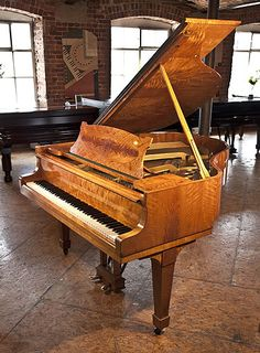 An 1936, Steinway Model S baby grand piano for sale with a flame, maple case and spade legs at Besbrode Pianos. Piano has an eighty-eight note keyboard and a two-pedal lyre.