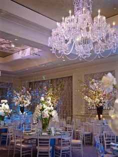 A gorgeous wedding at the Four Seasons Hotel - Boston. All of the gorgeous photos were captured by the talented Sarah Lawrence undergrad, Emma Wheeler. Call us today for a consultation at 617-482-6272. #luxurywedding #theworldofmarchall @fsboston @sarahlawerence @emmawheeler #weddingreception #centerpiece #white #purple #green #dogwoodbranch #orchid