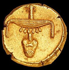 Gold stater of Nectanebo II (360-342 BC) the last native Egyptian pharaoh. | The gold stater was the first coin ever minted in ancient Egypt, around 360 BCE during the reign of pharaoh Teos of the 30th Dynasty. Teos introduced the gold stater in order to pay salaries of Greek mercenaries who were at his service. Teos' successor Nectanebo II kept this practice, though coining his personal gold staters.