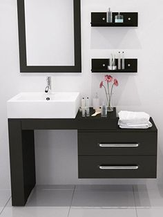 small but beautiful white bathroom with black modern vanity, flowers. Tiny Bathroom, Big Ideas: 5 Space Saving Ideas for Small Bathrooms by Tradewinds I. Bathroom Sink Cabinets, Bathroom Sink Vanity, White Bathroom, Bathroom Furniture, Bathroom Storage, Modern Bathroom, Sink Countertop, Cabinet Storage, Modern Furniture