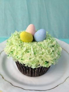 Chocolate Coconut (Snowball) Easter Basket Cupcake with Cadbury Eggs. Recipe by Trophy Cupcakes by Sara Klein