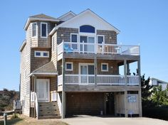 'Moon Struck' is a 6 bedroom vacation rental home located in Nags Head, Nc. WANT LOCATION? Look no further - THIS IS IT! Directly across the street from beach access.  Managed by Village Realty.  Property I.D. is JR30