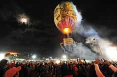 "Photo: Philip Heijmans for AJE  A hot-air balloon laden with fireworks takes to the sky.  Drawing tens of thousands of people from all around Myanmar to the ""wild west"" town of Taunggyi the Tazaungdaing Festival of Lights is held each year at the end of the rainy season around the time the moon is full.  Hundreds of 25 to 30-foot high hot-air balloons with fireworks and candles strapped to the bases are launched skyward in what is considered to be one of the most beautiful and dangerous…"
