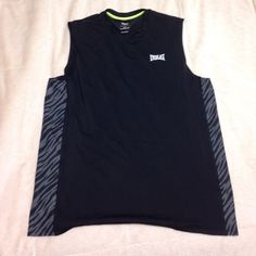 NWOT Work out tank Size xl i believe its mens but i have two of these and wear mind over leggings and a sports bra for dance class. So cute Tops Tank Tops