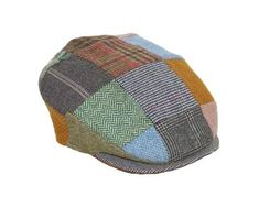 Treat yourself or another who is Irish at heart with our patchwork tweed caps! Imported from Hanna Hats Ireland, you are assured of quality, great fit, and exclusive tweeds. Age-old tradition of weaving in the homes of Donegal so many, many years ago is carried on today at the Hanna Hats factory. Given the patchwork tweed design, this is one of the most individual caps in our range. Please note! Caps may not look exactly as pictured as tweed samples are chosen randomly.