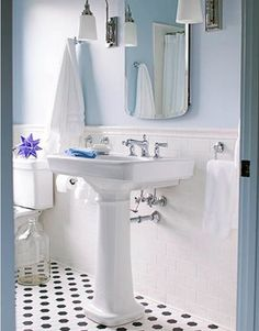 big hex, subway tile with tile molding, pedestal sink, blue walls,  chrome  - house beautiful