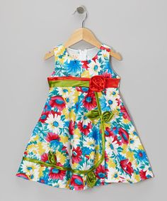 A flower-embellished bow is planted upon the bodice of this blooming dress, spurring the petals on the skirt to reach as high. With a zip-up back, this convenient number will inspire bitty blossoms to have a delightful day the moment they put it on.