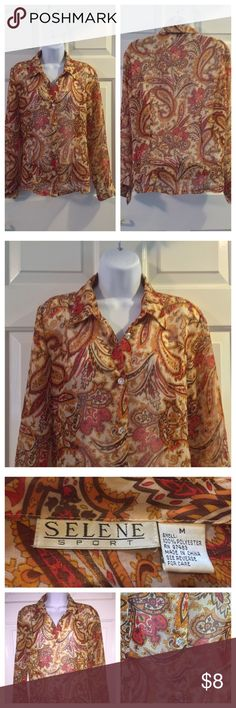 "Vintage Selene Sport SIZE MED Floral Blouse In really good preowned condition. No holes. No rips. No tears. Measurements:  armpit to armpit approx 20"". Top of the shoulder to the bottom of the hem approx 23"". Selene Sport Tops Blouses"