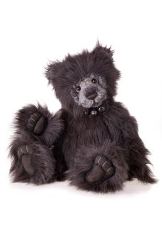 Lancelot is a plumo bear from the Charlie Bear 2012 collection.  At 56cms(22″) Lancelot is a large bear with long black fur, a grey shaved mohair muzzle, gorgeous eyes, a hand stitched brown nose, hand sculpted black paws, he wears a dog collar with seven bells. http://charlieteddybears.net/store/?p=511