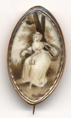 The vacant seat brooch....soooo sad and rather touching.  The lady is pointing to the empty seat next to her......circa 1770-90
