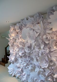 paper flower wall: I am so in love with this idea, I want to marry it. There are two problems: first, hubby would never go for it. second, if he did, the cats would eat it. :(