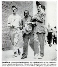 """""""BEATEN NEGRO, still clutching his blood-stained hat, is helped to safety by two white youths. Negroes reported many instances of white aid during the riot. Some white streetcar passengers hid Negros under their seats and on sat on top of them to keep them away from the rioters."""""""