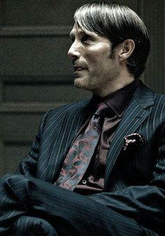 Mads Mikkelsen in Hannibal  His tongue.... Do you see it peeking out between his lips.? *Suffocates at Hannibal's tongue*.. That beautiful, sick murderer!