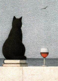 a sweet kitty a good book and a glass of wine ahhhh......