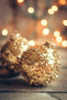 Golden christmas ornaments on rustic background by Alena Haurylik / Christmas Mood, Noel Christmas, Christmas Colors, Christmas Photos, Christmas Bulbs, Christmas Decorations, Wallpaper Natal, Christmas Wallpaper, Flowers Wallpaper
