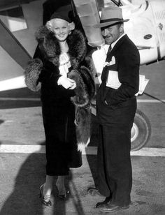 Jean Harlow and Harold Rosson arrive back in Los Angeles after getting married in Yuma, Arizona. September, 1933