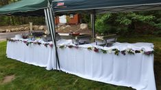 An outdoor party at home, no problem! Our client set up his tents over the buffet station that Tom's Market decorated with flowers.