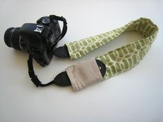 Strap Cover & spot for my lens cap!! @Christine Mills maybe for the camera strap you wanted...this tutorial doesn't look too bad!