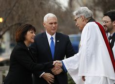 Rev Luis Leon greets Vice President-elect Mike Pence and his wife Karen upon their arrival...