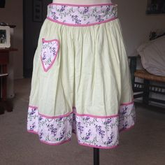 Anthropologie skirt. This skirt is so cute. Colors are amazing! Ties in the back w/floral trim & pocket. Anthro brand is Nick and Mo. I have a great Ann Taylor cotton top in my closet. Would be a perfect outfit!  Will bundle them. Anthropologie Skirts