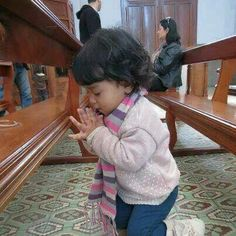 This sweet beautiful child on her knees, hands folded praying.  How precious.
