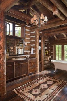 """This reminds me of r house. I LOVE this Rustic bathroom! Nice for a ranch home/hunting lodge. """"Beautiful and rustic log home bathroom with an abundance of warm-toned wood"""" Log Cabin Living, Log Cabin Homes, Log Cabins, Rustic Bathroom Designs, Rustic Bathrooms, Bathroom Ideas, Design Bathroom, Bathroom Layout, Log Home Bathrooms"""