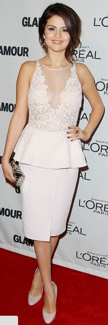 Selena Gomez:  Dress – Giambattista Valli    Shoes – Rupert Sanderson    Purse – Judith Leiber    Ring – Graziela