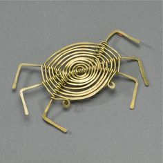 Alexander Calder, Untitled (Crab Brooch), hammered brass, 1/4 by 5 by 1/4 in. 8.3 by 12.7 by 0.6 cm.       Executed circa 1938, this work is registered in the archives of the Calder Foundation, New York