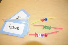 Stringing Words - The kids use pipe cleaners to build sight words and names. I'm not sure where these letters came from though.