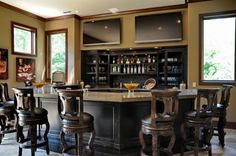 Nice basement bar- we're planning on having an English pub somewhere on our property...whether that ends up being in the future basement or in the loft of the shop that we're living in now remains to be seen