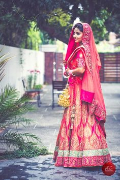 Bridal Lehengas - Bright Pink Lehenga with Gold Block Prints and Sea Green Border | WedMeGood #wedmegood #bridal #lehengas