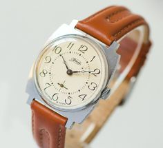This wristwatch ZIM made in factory named after Maslennikov in Kujbishev (now Samara). The factory opened at the beginning of the 20th century and