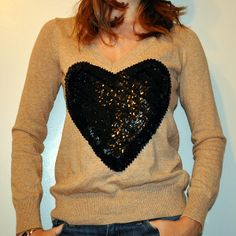 The J.Crew Heart Me sweater (sold out, of course) that has been seen all over blogland has inspired me to do some DIYing.  I thought sequins would help take the sweater to the next level!  The great thing about this DIY project is that NO sewing is involved....and it honestly took me under 20minutes!