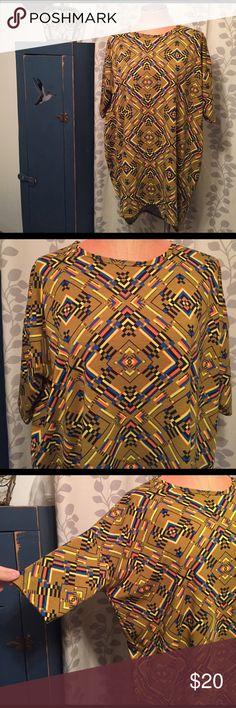 Lularoe Irma top M Fabulous Lularoe top, high lo design and made from a cotton type jersey fabric. Labeled a Medium. Light wear. LuLaRoe Tops