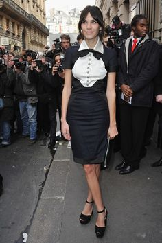 Alexa arrives at Pavillon Cambon to attend the Chanel show during Paris Fashion Week in a preppy collared cocktail dress with buttons and a bow tie.