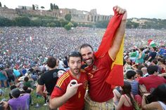 Spanish supporters stand in the middle of Italian supporters as they watch the final of the Euro 2012 tournament opposing Italy to Spain on a giant screen on July 2012 at a sea promenade in Naples. Defending champions Spain secured an unprecedented. Euro 2012, National Football Teams, European Championships, European Football, Naples, Finals, Spanish, Middle, July 1