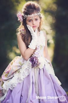 "Can you imagine your sweet little miss making a grand entrance wearing this fabulous girls victorian style dress from Love Baby J? Our ""Springtime In Paris"" Gown is a romantic confection of lilac, sag"
