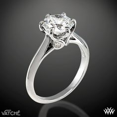 Superb craftsmanship is on full display with the 'Swan' Solitaire Engagement Ring by Vatche. This 6 prong beauty incorporates an open cathedral style shank with four surprise diamonds (0.07ctw; G/VS) nestled within the gallery of the head for that extra little sparkle. This is the sister ring to our 3 Stone 'Swan' Diamond Engagement Ring by Vatche.   The width of this r...