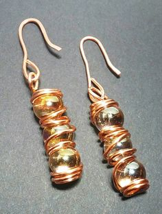 Glass beads wrapped and suspended in 100% copper. Beautiful, along with the good energy energy of copper. Made with handmade copper ear hooks.  Approx. length: 2 1/2 inches.
