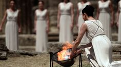 High priestess Ino Menegaki lights the Olympic flame using a parabolic mirror at the Temple of Hera during the lighting ceremony