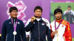 Gold medal winner Jinhyek Oh (C) of Korea poses with silver medal winner Takaharu Furukawa (L) of Japan and bronze medal winner Xiaoxiang Dai (R)of China after the men's Individual Archery gold medal match on Day 7 of the London 2012 Olympic Games at Lord's Cricket Ground