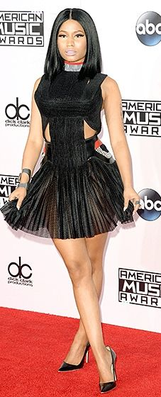 Nicki Minaj rapper wore a sheer minidress with cutouts by Alexander Wang.
