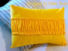 Ruffle-Panel Throw Pillow DIY. This is a little too plain. It needs an accent, but very cute idea.