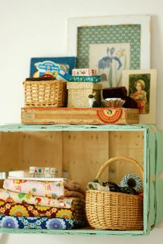 Could do this with crates. They sell them at Joann's and we could paint them fun colors. Perfect displays.