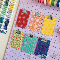 I can see these in my new sewing room.  They will be very colorful art work when not in use.