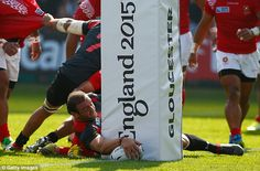 Georgia captain Mamuka Gorgodze scores his side's first try after reaching for the line...