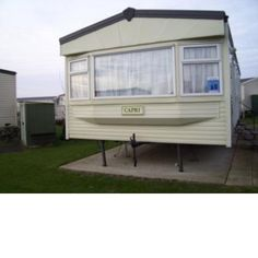 """3 Bedroom Caravan for rent. Butlins Skegness Lincolnshire.PE25 1NJ Cosalt Capri Situated on the RETREAT at the Butlins Skegness Skyline Caravan Village, this mobile home has central heating and double glazing, making it a home from home at any time of year. The living accommodation is spacious, with a 21"""" TV, DVD and Freeview Box. The kitchen is well equipped with a large built in fridge freezer, in addition to all usual kitchen items. There are 3 bedrooms."""